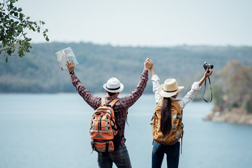 Couple family traveling together,Tourist couple Backpack along m